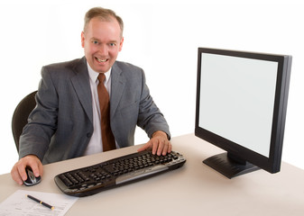 Middle Aged Businessman Sitting at his Desk