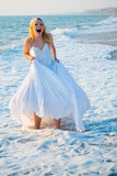 Shouting bride in sea spume