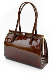 Brown leather handbag against a white background