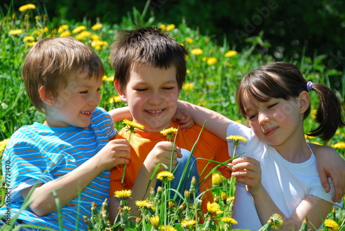 Kids in meadow of flowers