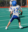 Youth Football Player Ready to Catch Ball