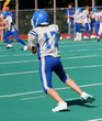 Youth Football Player Just Catching Ball