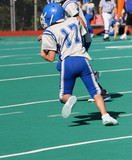 Youth Football Player Running with Ball poster