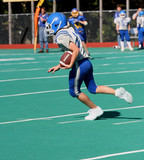 Youth Football Player Running with Ball 2 poster