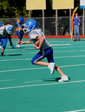 Youth Teen Football Player Running With the Ball poster