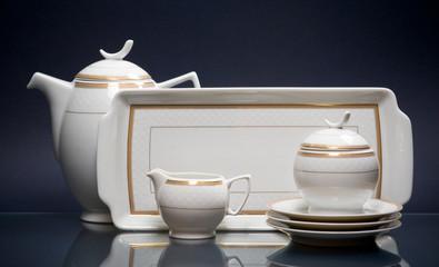 White china tea-set on blue