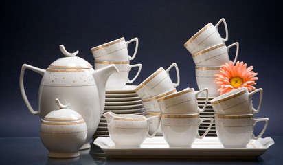 White china tea-set with flower on blue