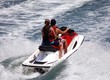 Boy and Girl Riding Tandem on a Jetski