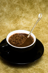 black cup of coffee with spoon