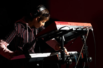 girl playing on synthesizer