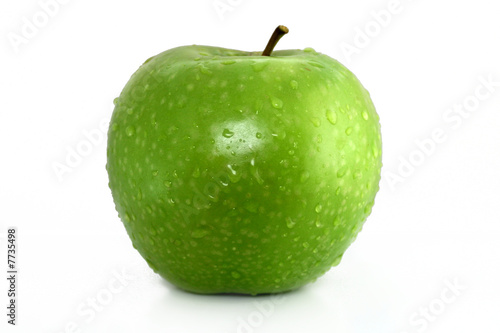 green apple with water drops on white background