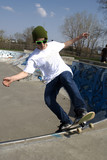 Skateboarder doing trick on ramp poster