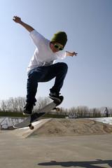 Lone skateboarder doing an ollie