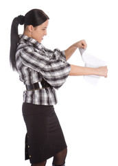 Business women tearing paper list
