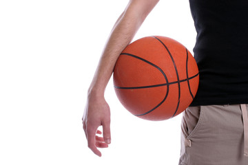 Detail of casual man holding a basketball ball