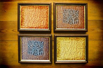 frames with leather texture on wooden wall
