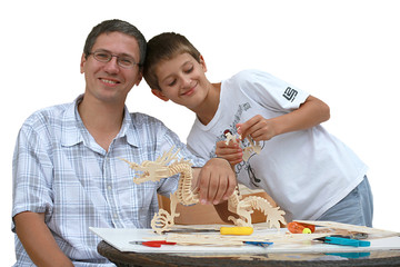 Father and son making wood project together