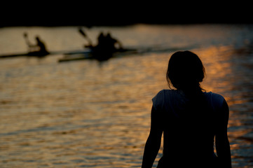 Watching canoeing at dusk