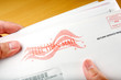 Voter receiving ballot in mail - 7753487