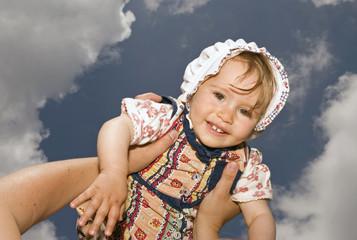 baby on cloud sky
