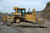 Huge bulldozer in a stone pit poster