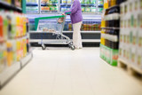 Supermarket buyer with shopping cart poster