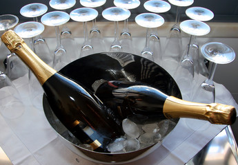 champagne bottles on a bowl