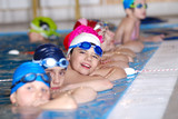 Fototapety .childrens in serie at swimming pool