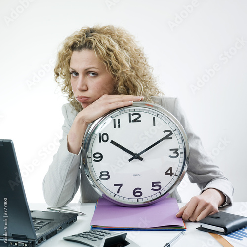 Bored woman with clock