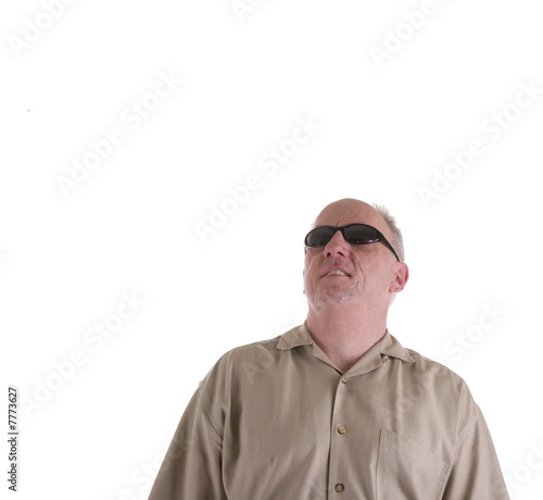 Man in Brown Shirt and Sunglasses Looking Up