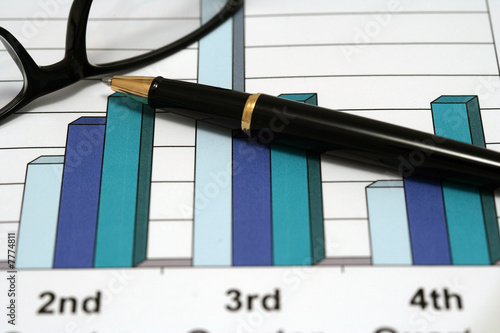 A pen and glasses  on a chart 2