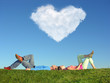 young pair lays on grass, In sky cloud in form of heart