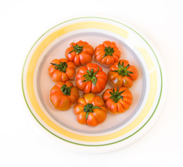 dish of ripes italian tomatoes