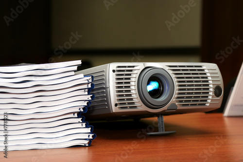 Projector with pile of books