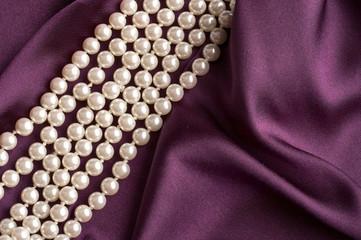 pearls on purple satin