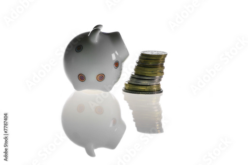 Piggybank and coins in white