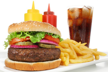 Hamburger meal served with french fries and soda close-up