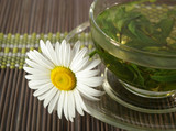 Cup of herbal tea and chamomile poster