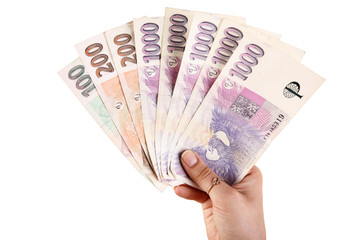 Hand with czech money
