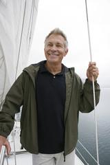 Man standing on yacht, portrait