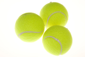 Three yellow tennis balls isolated on white background