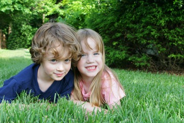 2 kids in the grass