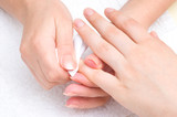 manicure applying - wiping the moisturizer from cuticles poster