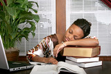 businesswoman asleep on a stack of books poster