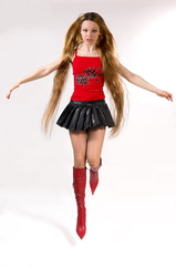 The beautiful girl with long hair jumps