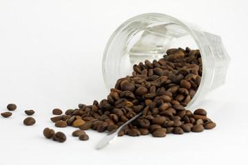 Coffee grains and upset glass
