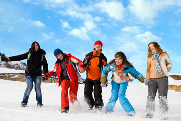 Group of sport teens different ethnicity jumping winter outdors