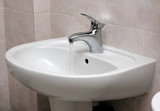 Open modern water faucet and basin poster