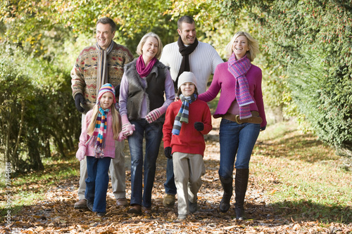 Multi-generation family on walk through woods
