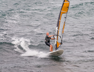 Windsurfer sufing on the sea of beach Pozo Izquierdo. Gran Canar